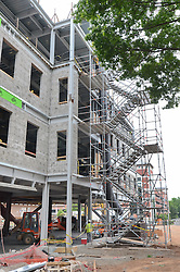 Central Connecticut State University.  New Academic Building.  Project No: BI-RC-324.Architect: Burt Hill Kosar Rittelmann Associates    Contractor: Gilbane Building Company, Glastonbury, CT..James R Anderson Photography   New Haven CT   photog.com.Date of Photograph: 19 June 2012   Image No. 28   Vertical Print.Camera View: North. East Elevation and scaffolding.