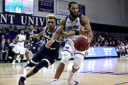 HIGH POINT, NC - JANUARY 06: Charleston Southern's Christian Keeling (left) and High Point's Jahaad Proctor (right). The High Point University of Panthers hosted the Charleston Southern University Buccaneers on January 6, 2018 at Millis Athletic Convocation Center in High Point, NC in a Division I men's college basketball game. HPU won the game 80-59.