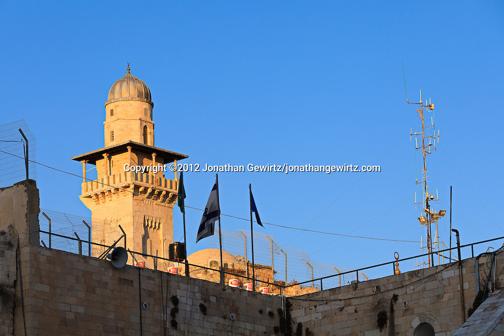 A minaret next to the Temple Mount and Western Wall in the Old City of Jerusalem. WATERMARKS WILL NOT APPEAR ON PRINTS OR LICENSED IMAGES.