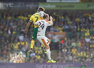 Norwich City's Ivo Pinter and Hull City's Max Clark during the EFL Sky Bet Championship match between Norwich City and Hull City at Carrow Road, Norwich, England on 14 October 2017. Photo by John Marsh.