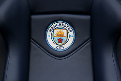 Manchester City branding on the seating in the dugout