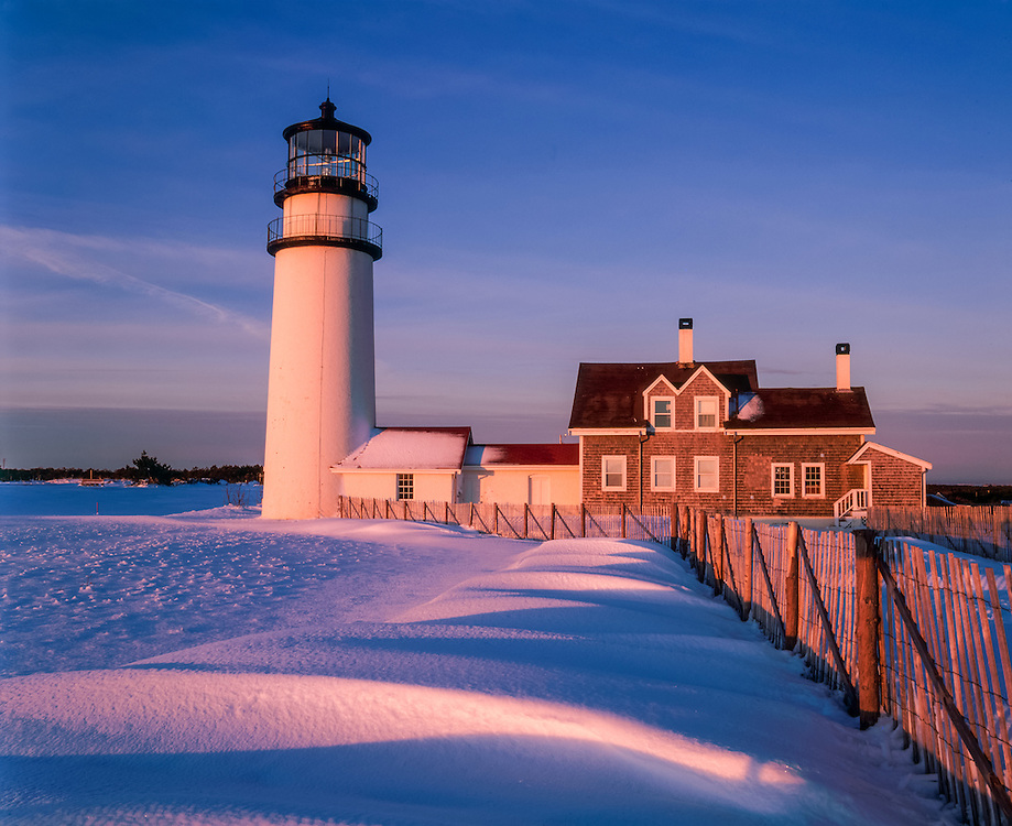 Cape Cod Light, Highland Light, in winter with snow drifts & fences at first light, Cape Cod National Seashore, North Truro, MA