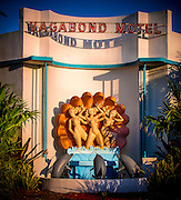 Late afternoon sunlight on a sculpture of nymphs and dolphins at the Miami Modern-style Vagabond Motel built in 1953. After a $5 million restoration it reopened on Miami's iconic Biscayne Bouevard in 2014. The original sculpture is by Juan Stacholy and the architect was Robert Swartburg, who also designed the landmark Delano Hotel in South Beach.