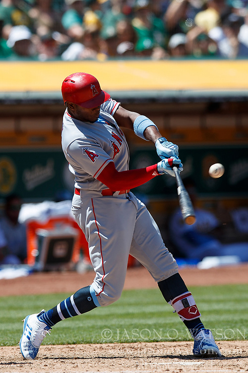 OAKLAND, CA - JUNE 17: Justin Upton #8 of the Los Angeles Angels of Anaheim at bat against the Oakland Athletics during the seventh inning at the Oakland Coliseum on June 17, 2018 in Oakland, California. The Oakland Athletics defeated the Los Angeles Angels of Anaheim 6-5 in 11 innings. (Photo by Jason O. Watson/Getty Images) *** Local Caption *** Justin Upton