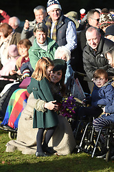 The Duchess of Cambridge and Princess Charlotte meet well wishers after attending the Christmas Day morning church service at St Mary Magdalene Church in Sandringham, Norfolk.