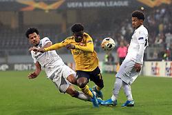 Vitoria Guimaraes' Lucas Evangelista (left) and Arsenal's Bukayo Saka (centre) battle for the ball