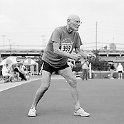 "Senior athlete Seymour Duckman, 88, of Daytona Beach, Florida, is photographed participating in the high jump during the track and field competition at the 2007 Senior Olympics, held at the University of Louisville's Cardinal Park Soccer & Track Stadium in Louisville, Kentucky on June 28, 2007. ..Duckman, who had just undergone his 11th chemotherapy treatment for lung cancer, has survived prostate, colon and kidney caner. (He had 18"" of his colon and a kidney removed)...Duckman ran track in high school then picked it up again in 1987- he also competed in long jump, shot put and discus at the Senior Games. His best jumps were 5'6"" as a high schooler and 4'2"" as a 75-year-old. ..""I'm a mess,"" he said. ""But I don't quit.""..The event was sponsored by the National Senior Games Association, established in 1986, which oversees 50 state and 350 local and regional competitions for senior athletes in the United States each year. There are an estimated 250,000 senior athletes in training in the U.S. ..."