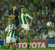 Photo Peter Spurrier<br /> 14/09/2002<br /> 2002 Real Betis vs Real Madrid  - Spanish Liga 1<br /> Real Madrid's, Fernando Morientes Sánchez, out jumps, Juanito Gutiérrez,