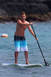 EXCLUSIVE: Rob Lowe shows he's still a heart-throb at 53 - as he shows off his toned beach body in Hawaii. The age-defying actor was seen paddle-boarding while on vacation in Kona, Hawaii. The West Wing star showed off his impressive and tanned physique as he wore a pair of blue, white and black board shorts to hit the waves. 08 Jul 2017 Pictured: Rob Lowe. Photo credit: MEGA TheMegaAgency.com +1 888 505 6342