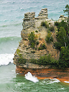 Waves of Lake Superior cut a hole in the sedimentary rock of Miners Castle, at Pictured Rocks National Lakeshore, Upper Peninsula, Michigan, USA.