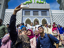 June 15, 2018 - Seoul, Gyeonggi, South Korea - Muslims from Indonesia pose for ''selfies'' at Seoul Central Mosque on Eid al Fitr, the Muslim Holy Day that marks the end of the Holy Month of Ramadan. There are fewer than 100,000 Korean Muslims, but there is a large community of Muslim immigrants in South Korea, most in Seoul. Thousands of people attend Eid services at Seoul Central Mosque, the largest mosque in South Korea. (Credit Image: © Jack Kurtz via ZUMA Wire)
