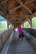 Wooden pedestrian bridge over the Inn River near Prutz, Tyrol, Austria