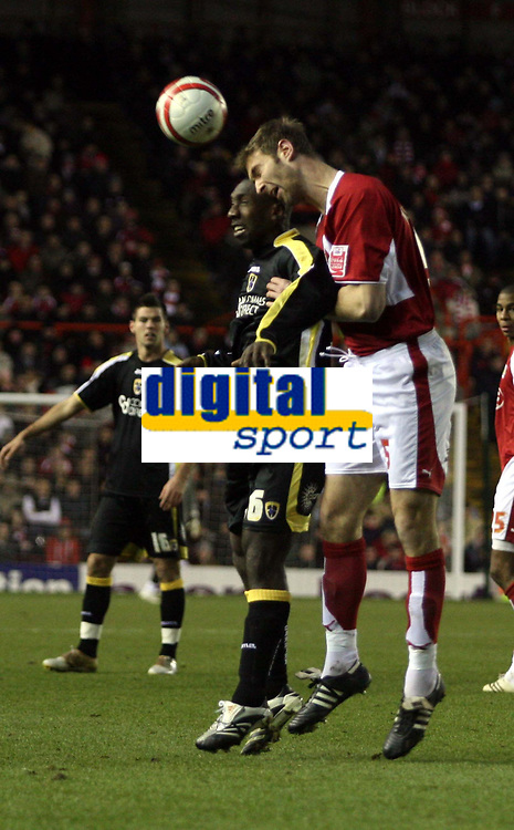 Photo: Mark Stephenson/Sportsbeat Images.<br /> Bristol City v Cardiff City. Coca Cola Championship. 15/12/2007.Bristol's Jamie McCombe wins the ball from Cardiff's Jimmy Floyd-Hasselbaink