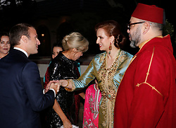 In this photo dated Wednesday, June 14, 2017 Morocco's King Mohammed VI, right, and his wife, hPrincess Lalla Salma, Ènd right, welcome French President Emmanuel Macron and his wife Brigitte Macron, center, before attending an Iftar meal, the evening meal when Muslims end their daily Ramadan fast at sunset, at the King Palace in Rabat, Morocco. The visit is the first by the recently elected French president to a North African country and aims to strengthen the relationship between France and Morocco, including cooperation on security issues. Photo by Abdeljalil Bounhar/Pool/ABACAPRESS.COM
