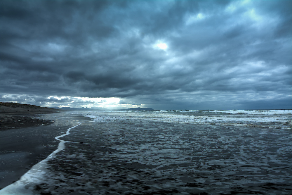 This wild seascape was shot as a storm was coming in from the Pacific Ocean at the Washington-Oregon border at the mouth of the Columbia River, photographed from the Oregon side.