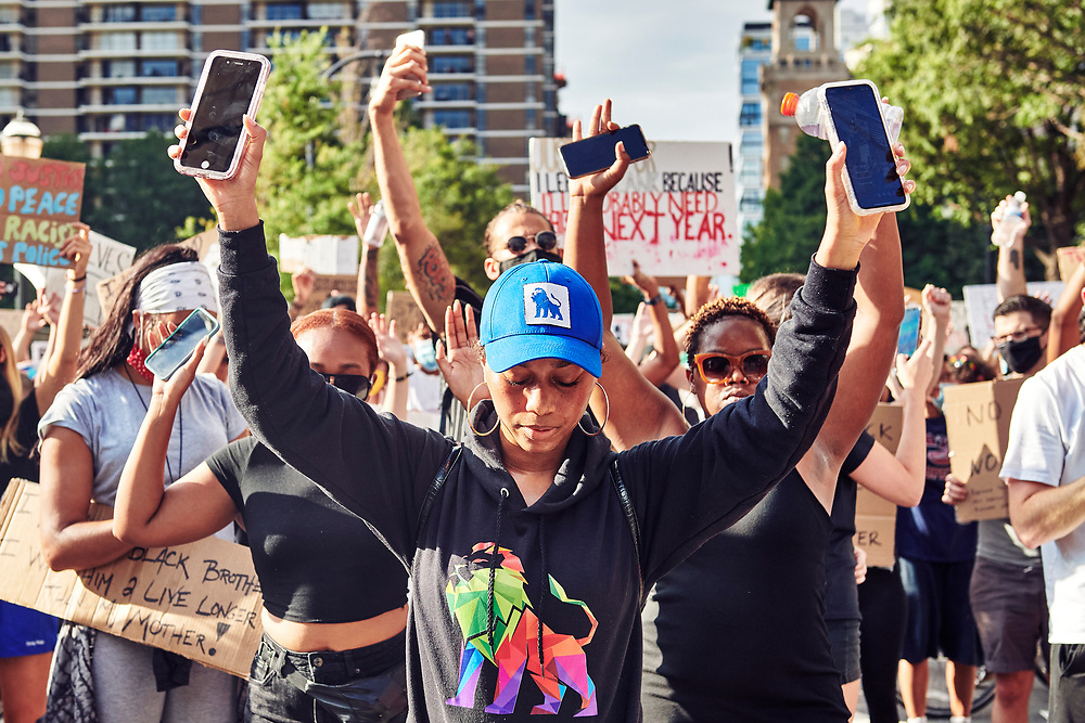 Black Lives Matter protesting the death of George Floyd march from Midtown Atlanta to Centennial Park.