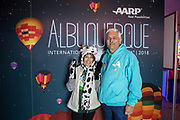 Grand prize winner Janet Sanchez with AARP New Mexico State Director Eugene Varela at the AARP Block Party at the Albuquerque International Balloon Fiesta in Albuquerque New Mexico USA on Oct. 8th, 2018.