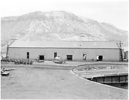 """An east-side view of D&RGW Durango car shop just before dismantling.<br /> D&RGW  Durango, CO  Taken by Payne, Andy M. - 2/29/1972<br /> In book """"Durango: Always a Railroad Town (1st ed.)"""" page 48<br /> Also in """"Grande Gold"""", p. 19."""
