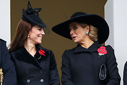 © Licensed to London News Pictures. 08/11/2015. London, UK. The Duchess of Cambridge and Dutch Queen Maxima watching the Remembrance Sunday ceremony in Whitehall, London on Sunday, 8 November 2015. Photo credit: Tolga Akmen/LNP