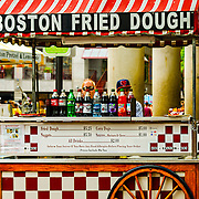 One of the many snack vendors around Faneuil Hall in Boston.  At that moment, they were not very busy.  Bad for them, great for my shot!