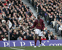 Photo: Lee Earle.<br /> Fulham v Arsenal. The Barclays Premiership. 04/03/2006. Arsenal's Emmanuel Eboue celebrates after scoring their second.