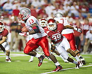 Sep 10, 2011; Little Rock, AR, USA; New Mexico Lobos running back James Wright (13) carries the ball while being persued by Arkansas Razorback linebacker Jarrett Lake (39) during the second half of a game at War Memorial Stadium. The Razorbacks beat the Lobos 52-3. Mandatory Credit: Beth Hall-US PRESSWIRE