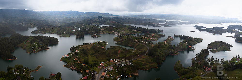 The overlook from El Penol, a large Monolith hovering over Antioquia area nd its large reservoirs outside of Guatape, Colombia. A multiple image stiched panoramic.