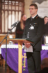 © Licensed to London News Pictures.  17/11/2013. THAME, UK. Chief Fire officer David Etheridge leads a prayer during the annual Road Deaths Memorial Service held in St Marys Church, Thame. 78 people were killed in traffic accidents in the Thames Valley Police area last year.    Photo credit: Cliff Hide/LNP