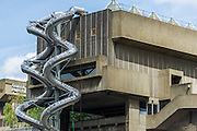 """Carsten Höller's helter-skelter (Isomeric) slides come back to London - at South Bank's Hayward Gallery.  The modern artist is probably most famous in London for his installation at the Tate Modern, in which children and grown ups alike could slide down a 56-metre long helter-skelter back in 2007 – this time they run from the gallery's glass pyramid ceiling to the entrance several floors below. They are part of Decision, the interactive exhibition which will run from June 10 to September 6 and will include - two robotic beds that will mirror each other's movements as they roam the gallery; and an installation called Flying Machines, which will be installed in the gallery's outdoor terrace opposite Waterloo Bridge, giving visitors """"the sensation of soaring above city traffic""""."""