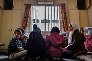 Syrian refugee children gather around foods before going to the private school on December 20th, 2018 at Homs League Abroad Tripoli Center in Tripoli, Lebanon. Tripoli Center holds extra class for their 85 Syrian students. Since Lebanese school teaches in English, they are suffering educational gap as a Syrian.