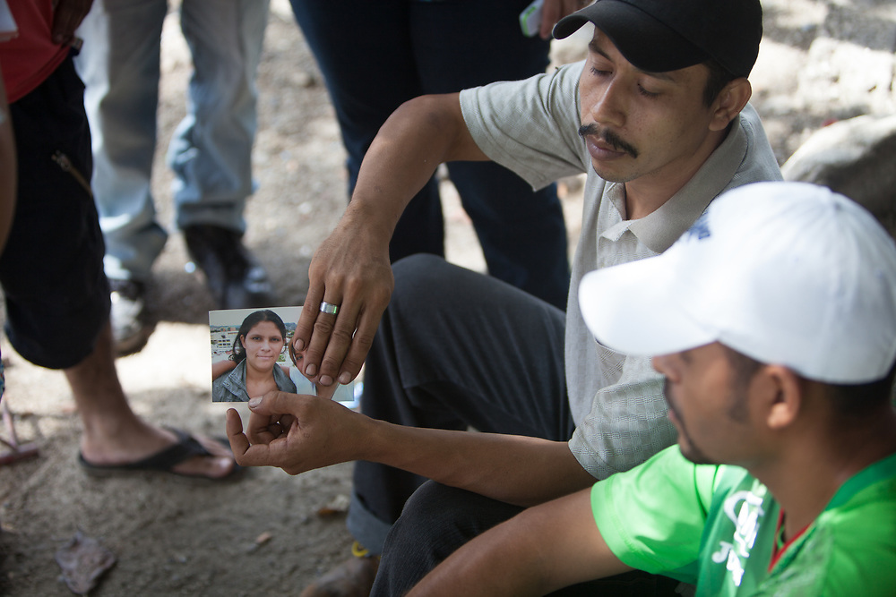 Family members wait for the release of bodies at the morgue in San Pedro Sula. Funeral service vehicles do brisk business with the current murder rate, the highest in the world.