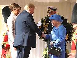 RETRANSMITTED CORRECTING BYLINE US President Donald Trump and his wife Melania are greeted by Queen Elizabeth II as they arrive at Windsor Castle, Windsor.
