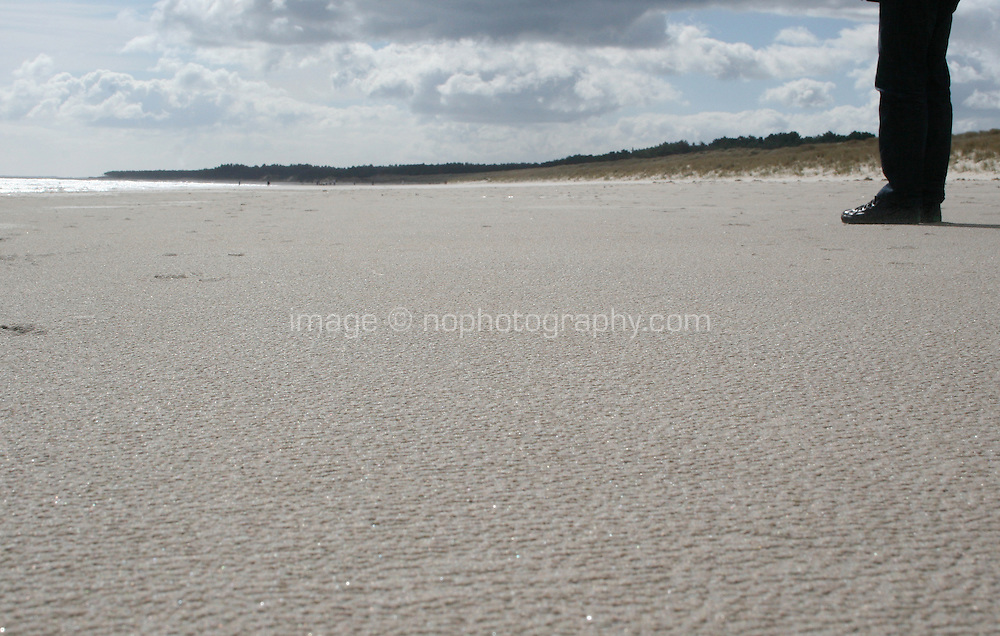 Man standing on Curracloe Beach in Wexford Ireland where the opening scenes of Spielberg's film Saving Private Ryan was filmed