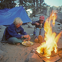 Youngsters devour Ramen noodles beside a blazing campfire in Big Pine Canyon of California's Sierra Nevada.