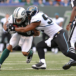 Nov 15, 2009; East Rutherford, NJ, USA; Jacksonville Jaguars linebacker Daryl Smith (52) tackles New York Jets tight end Dustin Keller (81) during second half NFL action in the Jacksonville Jaguars 24-22 victory over the New York Jets at Giants Stadium.