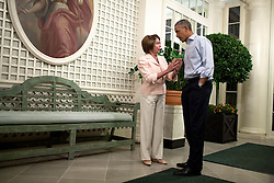 President Barack Obama speaks with House Minority Leader Nancy Pelosi, D-Calif. in the West Garden Room following the Congressional Picnic on the South Lawn of the White House, Sept. 17, 2014. (Official White House Photo by Pete Souza)<br /> <br /> This official White House photograph is being made available only for publication by news organizations and/or for personal use printing by the subject(s) of the photograph. The photograph may not be manipulated in any way and may not be used in commercial or political materials, advertisements, emails, products, promotions that in any way suggests approval or endorsement of the President, the First Family, or the White House.