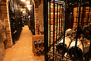 Wire cages with private wine collections through a vaulted brick entrance At the wine cellar storage company Grappe in Stockholm where private individual s can store and age wine bottles. Källaren Grappe Wine Storage Cellar, Stockholm, Sweden, Sverige, Europe