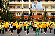 A large group of pupils in uniform doing exercises in unison in the school yard, Dalat, Lam Dong Province, Vietnam, Southeast Asia