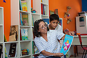 Neusa Araujo Dias reading books to the children in the community library, Biblioteca Comunitaria do Arquipelago, Porte Alegre, Brazil. <br /> <br /> Neusa works fulltime in the library.<br /> <br /> Cirandar is working in partnership with  C&A and C&A Instituto to implement a network of Community Libraries in eight communities of Porto Alegre.