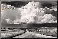Billowing storm clouds along East Powder River Road in Powder River County, Montana, USA