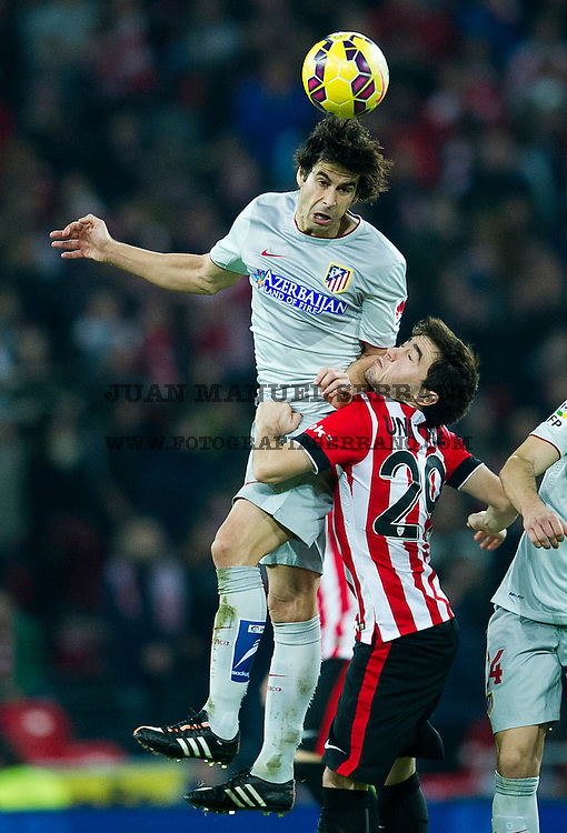 BILBAO, SPAIN - DECEMBER 21: Tiago Mendes of Atletico de Madrid competes for the ball with Unai Lopez of Athletic Club during the La Liga match between Athletic Club de Bilbao and Club Atletico de Madrid at San Mames Stadium on December 21, 2014 in Bilbao, Spain.  (Photo by Juan Manuel Serrano Arce/Getty Images)
