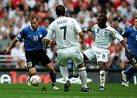 Photo: Tom Dulat.<br /> England v Estonia. UEFA European Championships Qualifying. 13/10/2007.<br /> Joel Lindpere of Estonia and Shaun Wright-Phillips(R) of England with the ball.