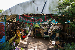 Sipson, UK. 5th June, 2018. A Transition Heathrow banner is pictured at the entrance to a covered area at Grow Heathrow. Grow Heathrow is a squatted off-grid eco-community garden founded in 2010 on a previously derelict site close to Heathrow airport to rally support against government plans for a third runway and it has since made a significant educational and spiritual contribution to life in the Heathrow villages, which remain threatened by Heathrow airport expansion.