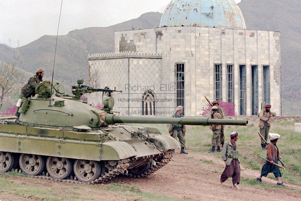 Afghan mujahideen fighters with Jamayat-E-Islami and a captured government Soviet made T-62 tank as they approach the capital April 18, 1992 in Kabul, Afghanistan. The Jamayat-E-Islami were the first to enter Kabul and took control of most of the strategic buildings in the city.