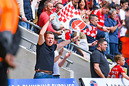 Charlton Athletic fan waves a flag during the EFL Sky Bet League 1 play off first leg match between Doncaster Rovers and Charlton Athletic at the Keepmoat Stadium, Doncaster, England on 12 May 2019.