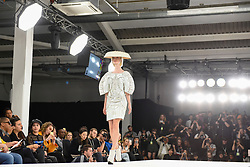 © Licensed to London News Pictures. 07/06/2017. London, UK. A model presents a look during the International Showcase on the final day of Graduate Fashion Week taking place at the Old Truman Brewery in East London.  The event showcases the graduation show of up and coming fashion designers from UK and international universities. Photo credit : Stephen Chung/LNP