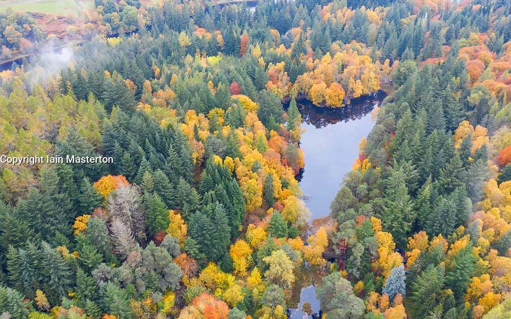 Aerial view of autumn colours of woodland at Loch Dunmore in Faskally Wood near Pitlochry in Perthshire.