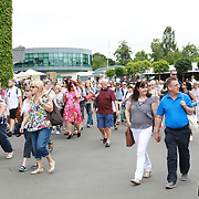LONDON, ENGLAND - JULY 16: The gates open at Wimbledon on Men's Final Day during the Wimbledon Lawn Tennis Championships at the All England Lawn Tennis and Croquet Club at Wimbledon on July 16, 2017 in London, England. (Photo by Tim Clayton/Corbis via Getty Images)