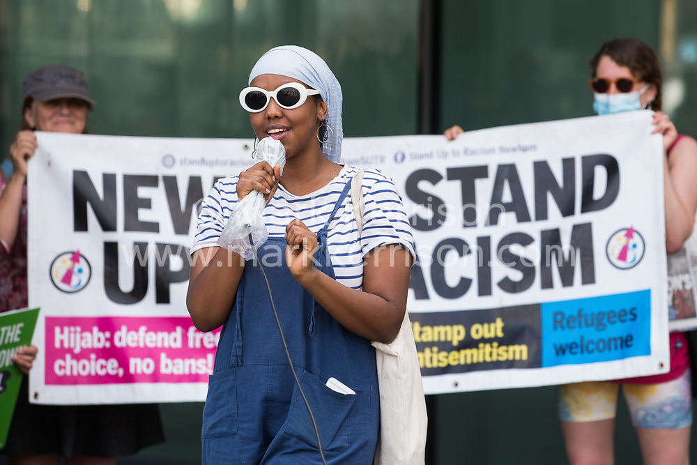 London, UK. 5th June, 2021. Naima Omar of Stand Up To Racism addresses environmental activists and local residents protesting against the construction of the Silvertown Tunnel. Campaigners opposed to the controversial new £2bn road link across the River Thames from the Tidal Basin Roundabout in Silvertown to Greenwich Peninsula argue that it is incompatible with the UK's climate change commitments because it will attract more traffic and so also increased congestion and air pollution to London's most polluted borough.