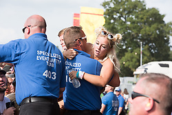 August 26, 2017 - Reading, Berkshire, UK - Reading Festival 2017, Reading, UK. Main stage crowds and security helping exhausted audience members pictured  (Credit Image: © Andy Sturmey/London News Pictures via ZUMA Wire)